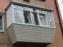 Фото после обшивки балкона сайдингом